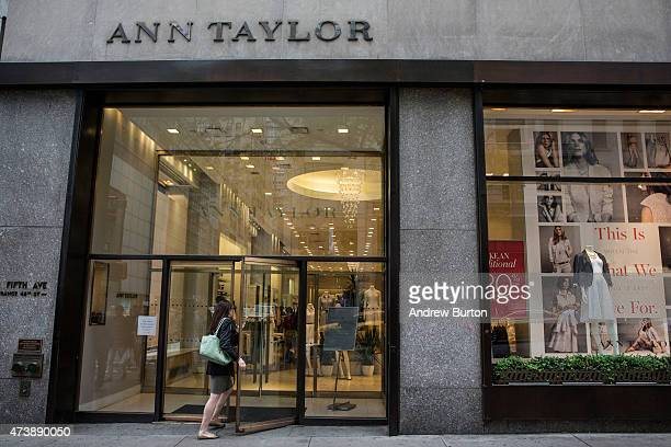 People pass the window display of an Ann Taylor women's clothing store in Manhattan on May 18 2015 in New York City Ascena Retail Group which owns...