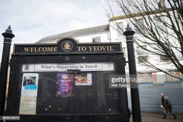 People pass the window of aN empty shop in the town centre of Yeovil on February 2 2017 in Somerset England Business rates which are based on the...