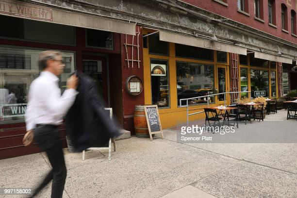 People pass the wine bar and music venue City Winery in lower Manhattan on July 12 2018 in New York City The Walt Disney Co which has announced that...