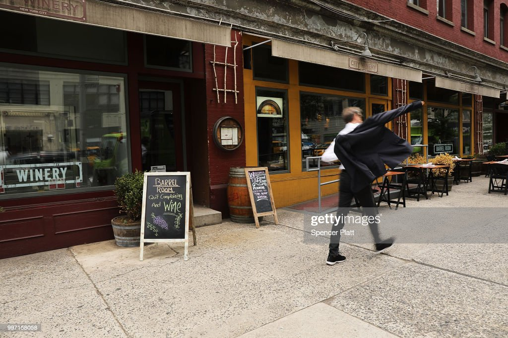 People pass the wine bar and music venue City Winery in lower Manhattan on July 12, 2018 in New York City. The Walt Disney Co., which has announced that it will move its New York City headquarters from the Upper West Side to Hudson Square, will be taking over the block by 2020, forcing the popular venue to relocate. The 30,000-square-foot location is part of the 4 Hudson Square site for which Disney bought the development rights.