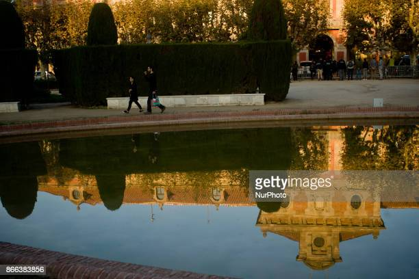 People passes by as Catalonian Parliament building is seen reflected on the water in Barcelona Spain on 25 October 2017 Spanish government aims to...