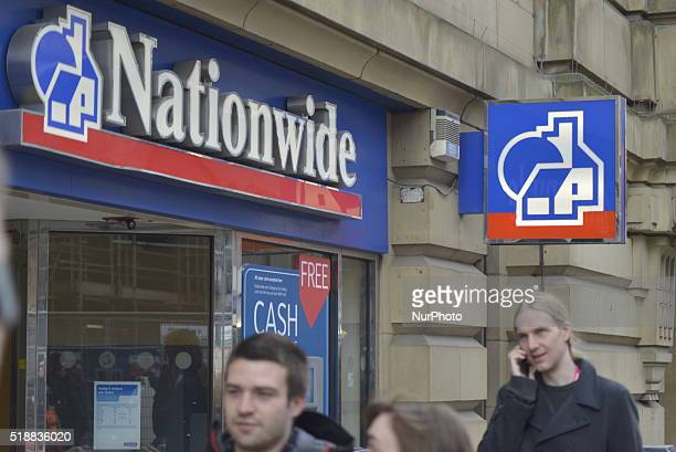 People passing a branch of the Nationwide Building Society in Manchester Greater Manchester England United Kingdom on Wednesday 30th March 2016 The...