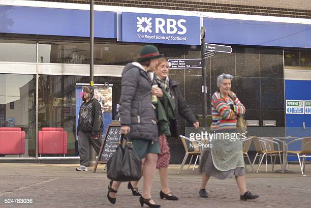 People passing a branch of the Royal Bank of Scotland in Stockport Greater Manchester England United Kingdom on Friday 26th February 2016 The Royal...