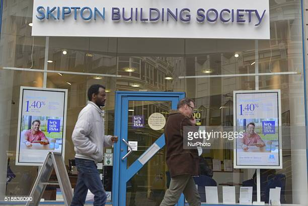 People passing a branch of the Skipton Building Society in Manchester Greater Manchester England United Kingdom on Wednesday 30th March 2016 The UK...