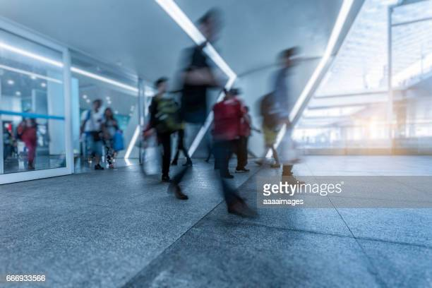 people passing at a  busy airport