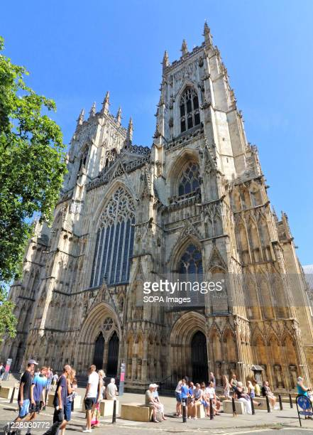 People passing by the main facade of York Minster, the city's famous cathedral. Daily life in Yorkshire, the largest county in England, UK.