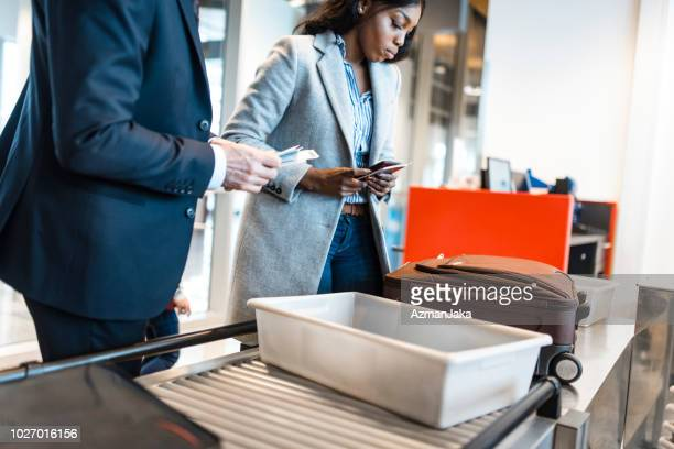 people passing security check on the airport - security stock pictures, royalty-free photos & images