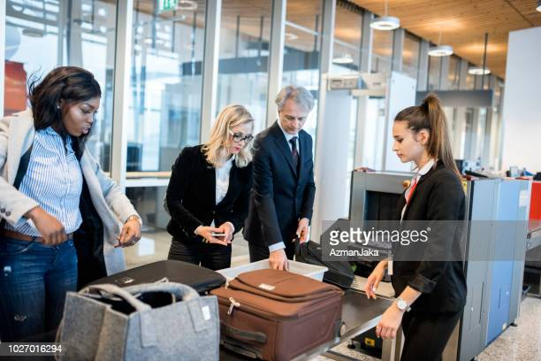 people passing security check on the airport - metal detector security stock pictures, royalty-free photos & images