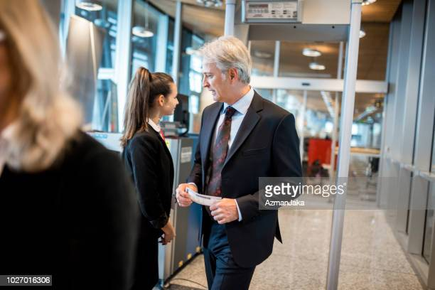 people passing security check on the airport - metal detector stock photos and pictures