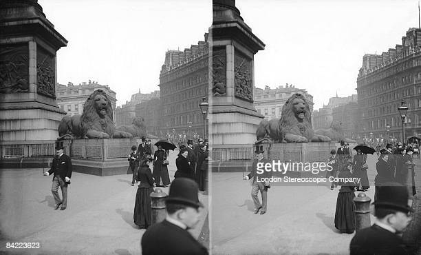 People passing the base of Nelson's column in Trafalgar Square London circa 1890