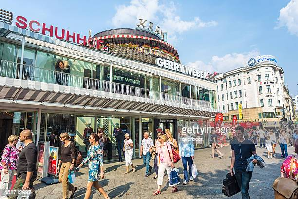 people passing the shopping mall kranzler eck in berlin - kurfürstendamm stock pictures, royalty-free photos & images