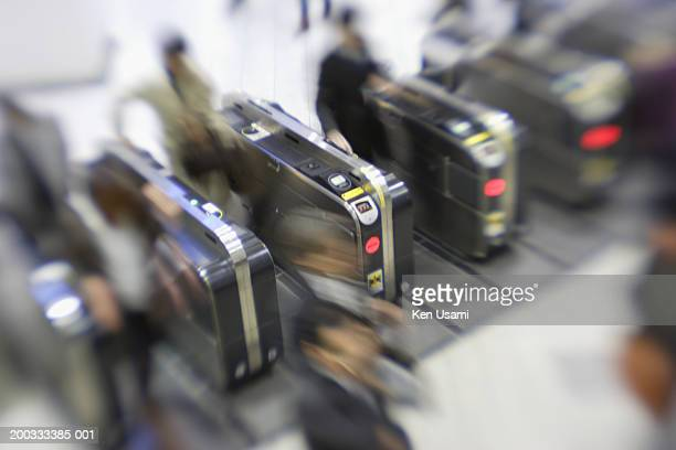 people passing through automatic ticket gate (blurred motion) - 改札 ストックフォトと画像