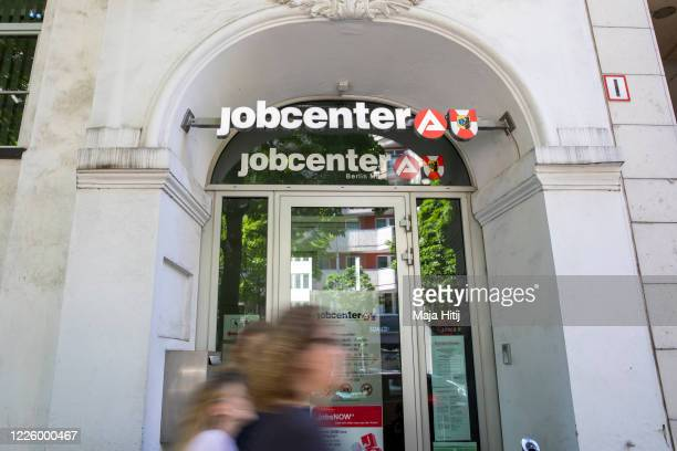 People past by an employment agency during the coronavirus crisis on May 20, 2020 in Berlin, Germany. The coronavirus pandemic has caused German...