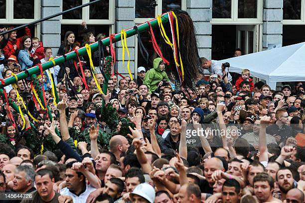 People patricipate in the Ducasse Doudou folkloric festival in Mons on June 3 2012 In 2005 UNESCO declared the Doudou festival a masterpiece of the...
