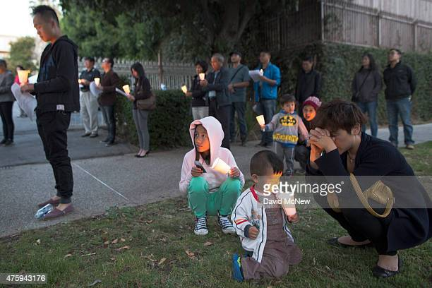 People pause for a moment of silence during a candlelight vigil near the Los Angeles Chinese Consulate to commemorate the anniversary of the 1989...