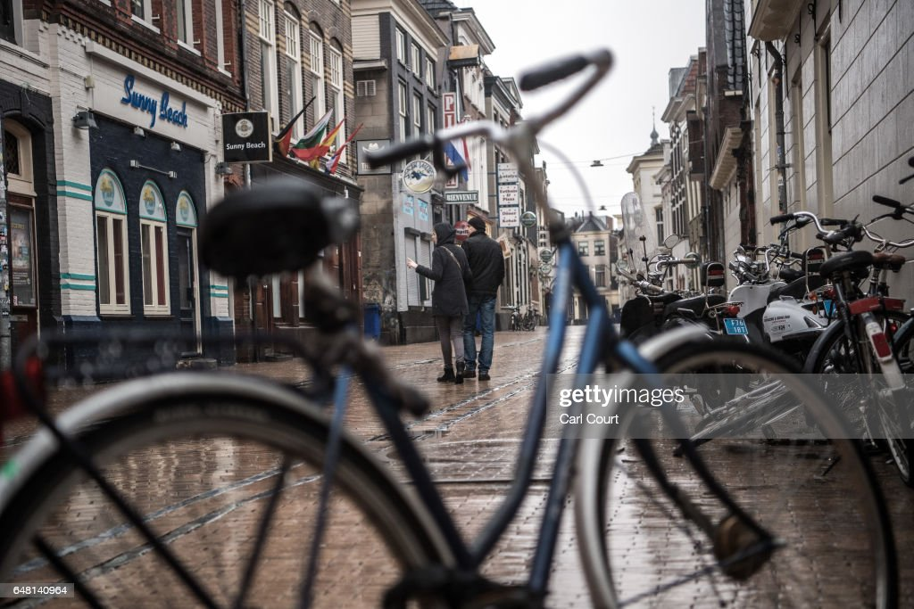 People pause in a street on February 23, 2017 in Groningen, Netherlands. The Dutch will vote in parliamentary elections on March 15 in a contest that, according to some polls, is currently led by far-right candidate Geert Wilders, the leader of the anti-Islam Party for Freedom (PVV). The Dutch election is the first of three prominent Eurozone elections with Germany heading to the polls on September 24 and the first round of the French presidential elections taking place on April 23.