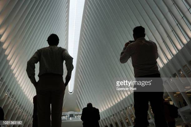 People pause in the World Trade Center Oculus as the retractable skylight is opened during a morning commemoration ceremony for the victims of the...