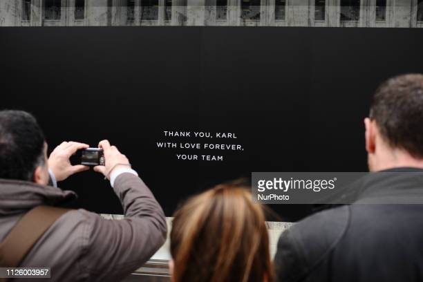 People pause to look at a message of tribute to late fashion designer Karl Lagerfeld at his store on Regent Street in London England on February 20...