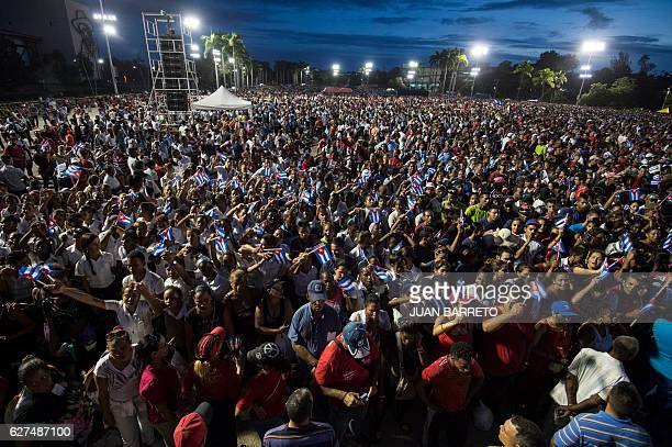People pay homage to the late Cuban leader Fidel Castro during the last ceremony before his burial in Santiago de Cuba the cradle of his revolution...