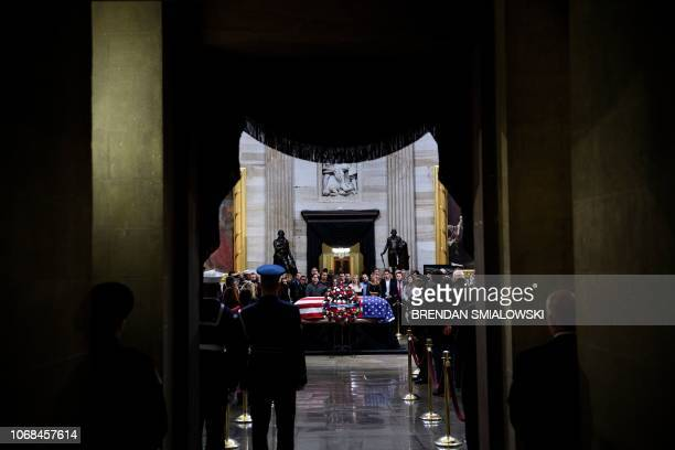 People pay respects as the remains of former US President George H W Bush lie in state in the US Capitol's rotunda December 4 2018 in Washington DC...