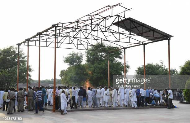 People pay their last respect during the cremation ceremony of former Prime Minister Atal Bihari Vajpayee at Rashtriya Smriti Sthal on August 17 2018...