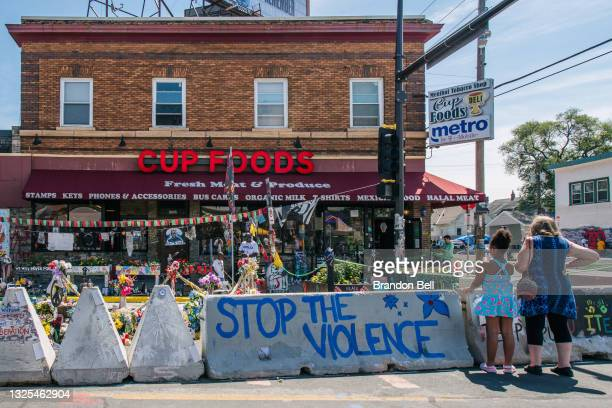 People pay their respects, ahead of former Minneapolis police officer Derek Chauvin's sentencing, at the intersection of 38th Street and Chicago...