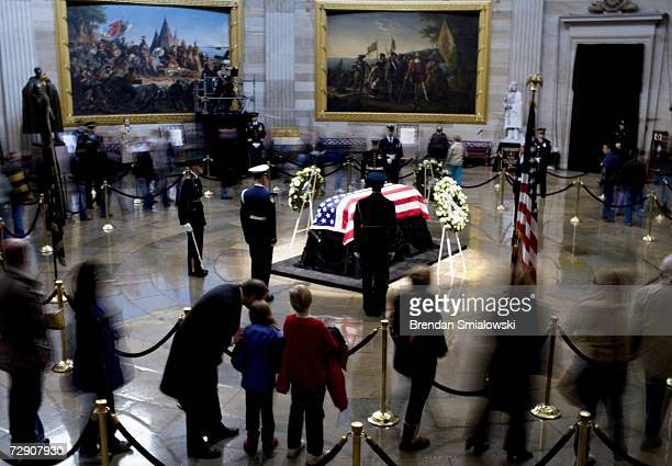 People pay their respects as former US President Gerald Ford as he lies in state at the rotunda of the US Capitol December 31 2006 in Washington DC...