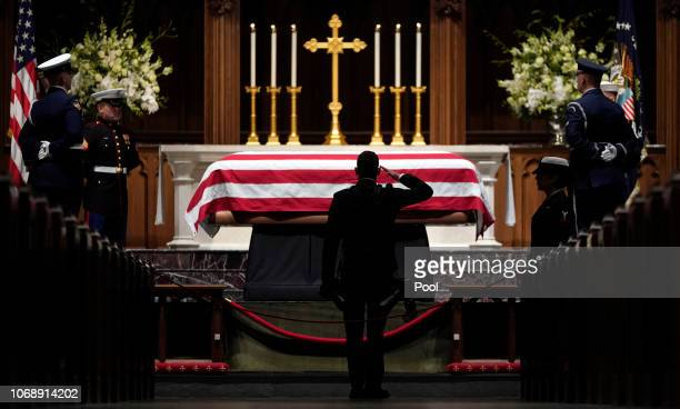 People pay their respects as the flagdraped casket of former President George HW Bush lies in repose at St Martin's Episcopal Church on December 5...