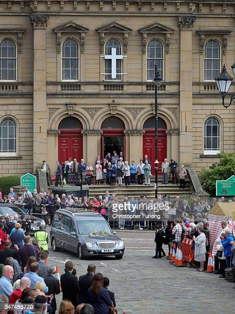 People pay their respects as the funeral cortege of murdered member of parliment Jo Cox processes through Market Place in her constituency on July 15...