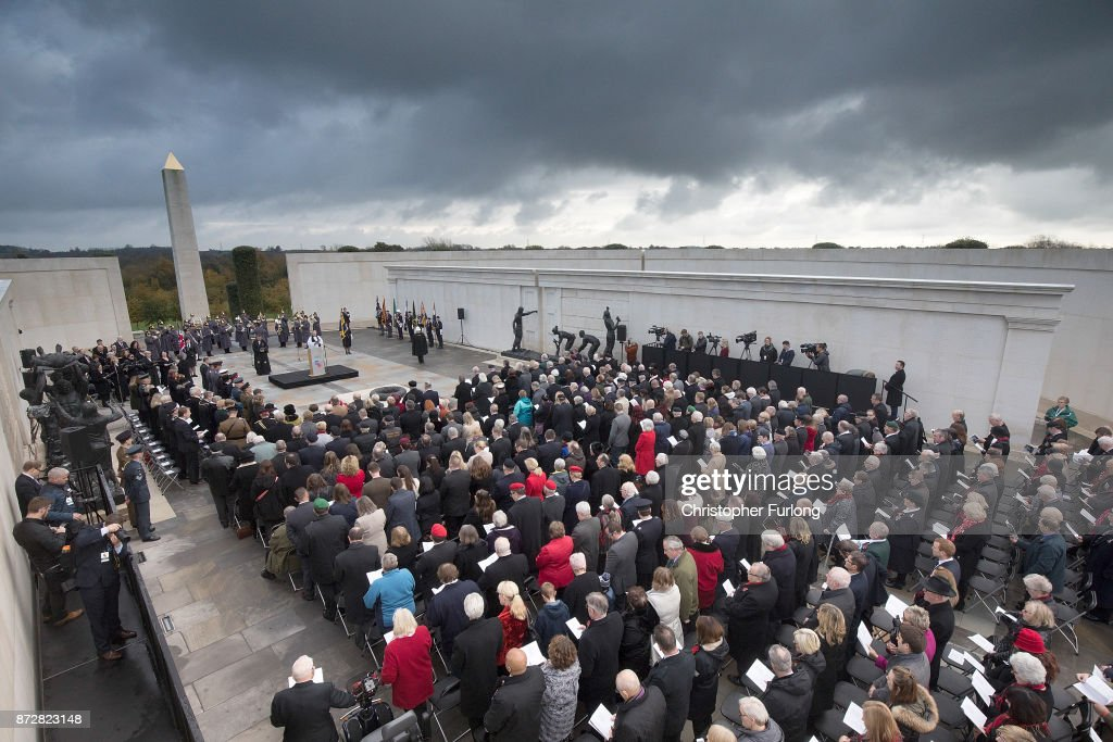People pay their respects as they the annual Armistice Day Service at The National Memorial Arboretum on November 11, 2017 in Alrewas, England. Armistice Day traditionally marks the end of the WWI when Germany and the allied forces signed the armistice signaling the end of hostilities on the Western Front. The cessation of the war officially took effect on the eleventh hour of the eleventh day of the eleventh month and is marked annually by services of remembrance for all those who have fallen in wars and a two minute silence.