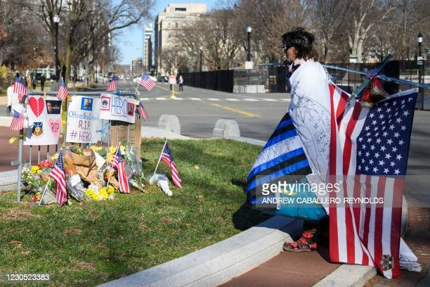People pay their respects at a memorial for fallen police officer, Brian Sicknick in Washington, DC on January 10, 2021. - US Capitol Police officer...