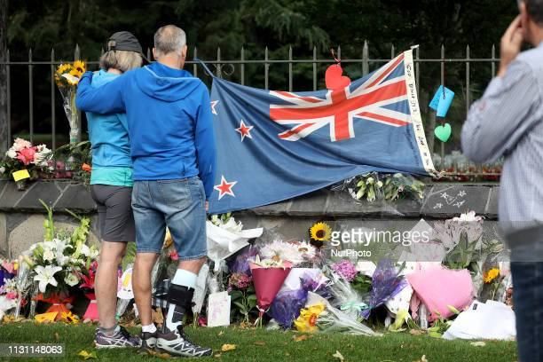 People pay their respects at a memorial outside the Botanical Gardens as a tribute to victims of the mosque attacks in Christchurch on March 17 2019...