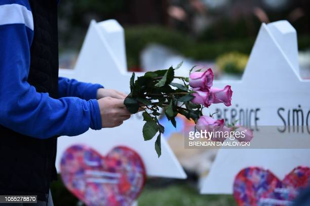 People pay their respects at a memorial outside the Tree of Life synagogue after a shooting there left 11 people dead in the Squirrel Hill...