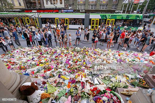 People pay their respects at at Bourke St Mall in Melbourne CBD which has become a tribute to the Bourke St victims at Bourke st Mall on January 23...