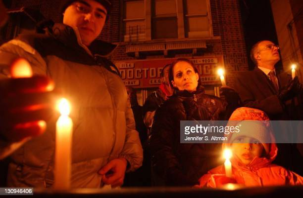 People pay their respects at the candlelight vigil for Amadou Diallo three years after he was killed by police at 1157 Wheeler Avenue in the Bronx NY