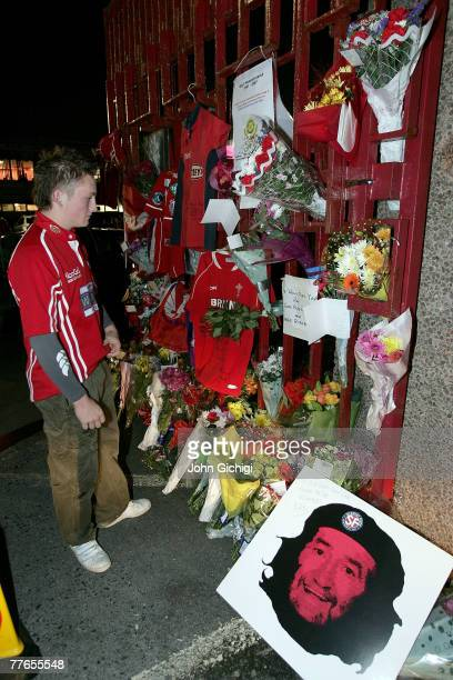 People pay their respects at the loss of Ray Gravell during the EDF Energy Cup game between Llanelli Scarlets and Leeds Carnegie at Stradey Park on...