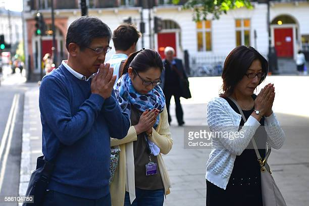 People pay their respects at the scene of a stabbing in which one woman was murdered on August 5 2016 in London England Darlene Horton a 64yearold US...