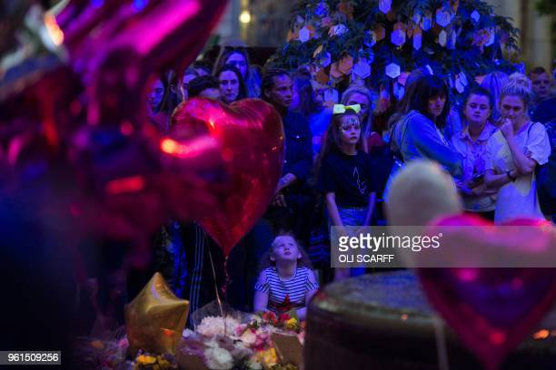 People pay their respects during a ceremony in central Manchester, May 22 marking the one year anniversary of the deadly attack at Manchester Arena....