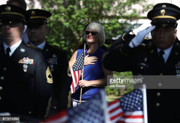 People pay their respects during the funeral of U.S. Army Sergeant Richard 'Tiny' Sowell as his remains are buried at Woodlawn Cemetery on November...