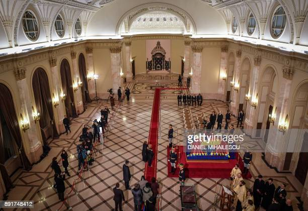 People pay their respects in front of the coffin of King Michael I of Romania on December 13 2017 at the former Royal Palace that houses the National...