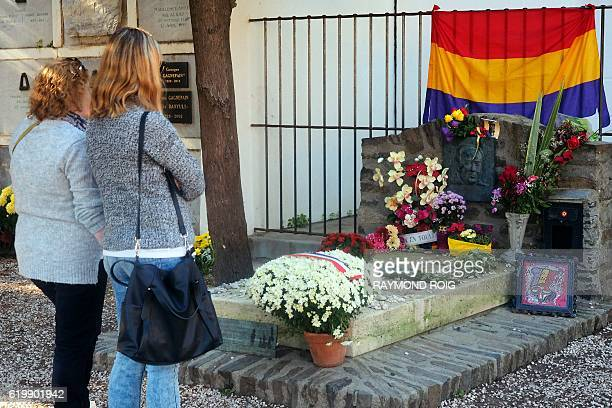 People pay their respects in front of the grave of Spanish poet Antonio Machado on November 1 2016 in a cemetery in Collioure southwestern France...