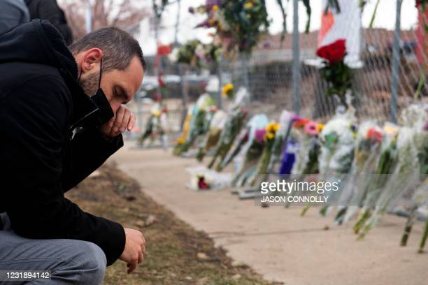 People pay their respects on March 23, 2021 to the ten victims of a mass shooting at a King Soopers grocery store in Boulder, Colorado. - Colorado...