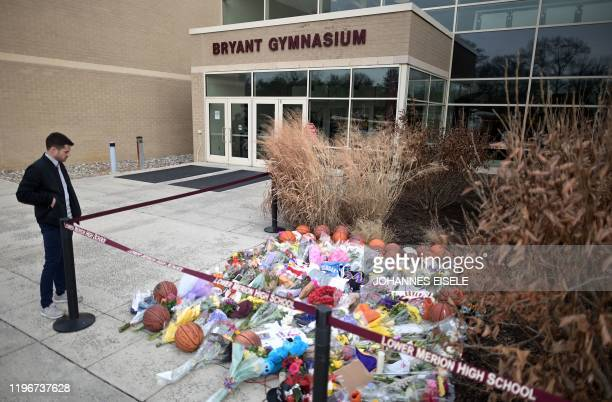 People pay their respects outside Bryant Gymnasium at Lower Merion High School where basketball legend Kobe Bryant formally attended school after his...