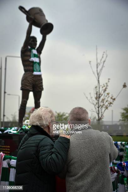 People pay their respects to Celtic football legend Billy McNeill who died on April 23 outside Celtic Park Glasgow on April 24 2019 Former Celtic...