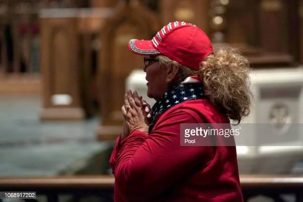 People pay their respects to former President George HW Bush as he lies in repose at St Martin's Episcopal Church on December 5 2018 in Houston Texas...