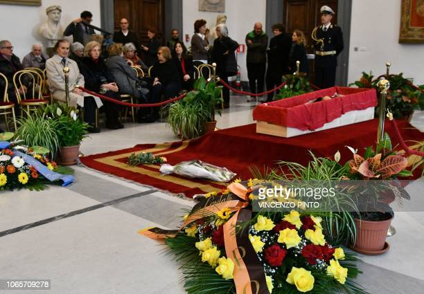 People pay their respects to Italian film director Bernardo Bertolucci lying in state in an open coffin in a chapel of rest at Rome's Capitol Hill on...