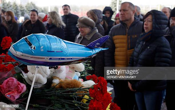 People pay their tribute to victims of the airplane crash in front of a makeshift memorial at the entrance of the RostovonDon airport on March 20...