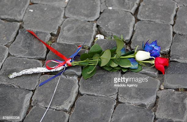 People pay tribute for Nice terrorist attack victims in front of the French Embassy to Italy, in tribute to the attack victims of Nice, in Rome, July...