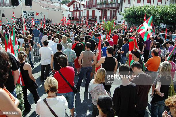 People pay tribute to Jon Anza a member of the armed Basque separatist group ETA on July 24 2010 in Ciboure southwestern France a day after his body...