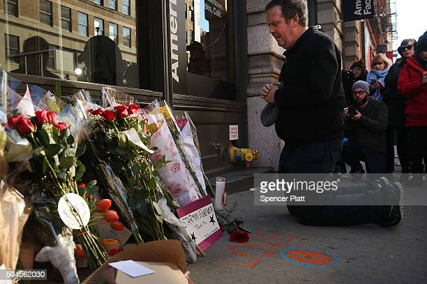 People pay tribute to the late musician and performer David Bowie at a memorial outside of the apartment he shared with his wife on January 11 2016...